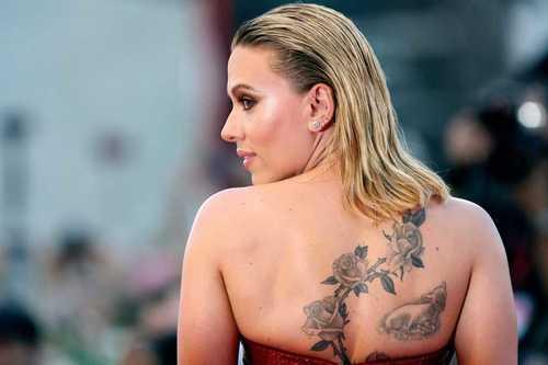 Scarlett-Johansson-Lamb-and-Flowers-Back-Tattoo