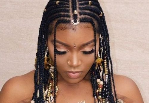Heavily accessorizedcornrow braids