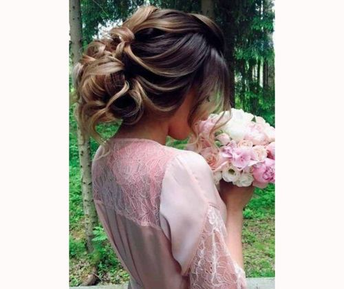 Relaxed Updo With Flowers