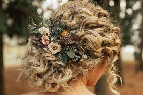 49 A floral updo for curly hair